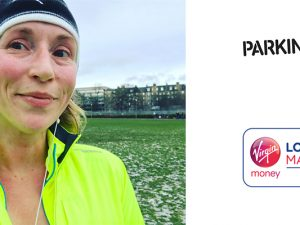 Gail Watts in a yellow top running. Logos for Virgin London Marathon and Parkinson's UK