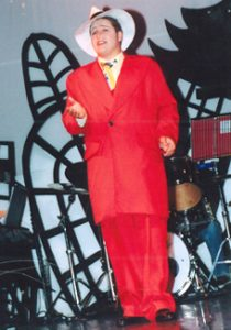 Boy acting dressed in a red 1930's suit