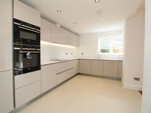 view of kitchen with white units