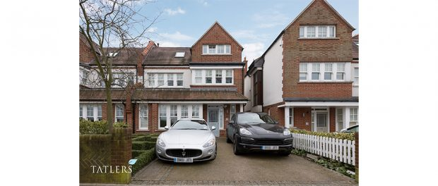 Street view of house with 2 cars parked on driveway