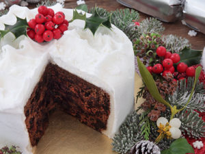 Iced and decorated Christmas cake with slice removed