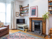 Living room with carpet, fireplace, windows
