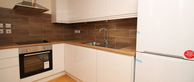 white kitchen of property to let