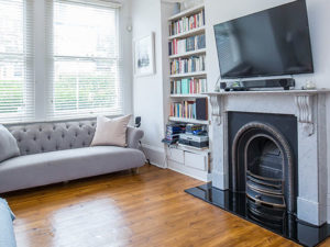 View of lounge with fireplace and bay window :To Let