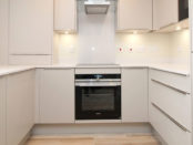 white kitchen with cooker centre
