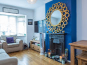 Lounge of property for sale with blue feature wall