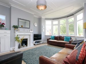 Grey painted Lounge with furniture, large bay, fireplace