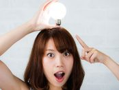 "Woman with lit lightbulb on her head - ""Lightbulb"" moment"