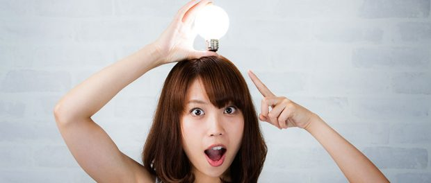 Woman with lit lightbulb on her head -