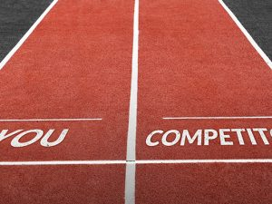running lanes with the words you and competitor denoting a race