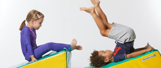 2 Children tumbling on mats