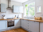 L-shape white and wood kitchen