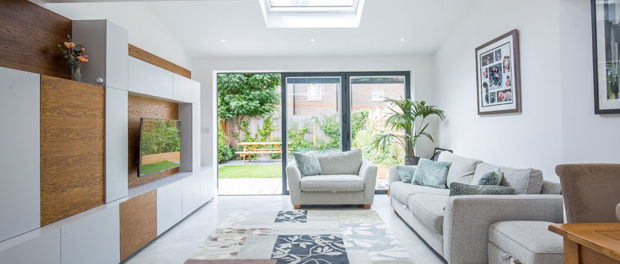 Living room with furniture view through sliding doors to garden