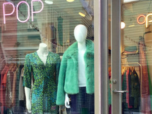 Manequins wearing green in window display
