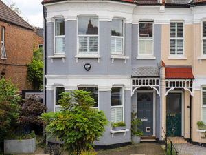 Grey painted double storey end of terrace house for sale