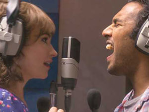 Man and Woman singing in recording studio