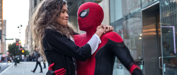 spiderman holding a woman close