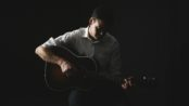 Shadow picture of musician James McFadden playing guitar